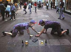 Artist Julian Beever, of the U.K.  One's real, the other's chalk.